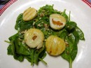 Welcome chez VOAHANGY, one of our signature plate: sauteed scallops on a bed of baby spinach.