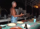 Mahini (The Godfather) preparing the wonderful pizza in his brickfire oven.