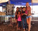 Monica and some of the local kids in the beer garden at the horse races.