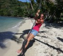 Monica swinging on the mooring line on Nananu-i-ra Island.