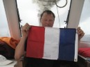 In preparation of landing: Uwe prepares the French Flag for landing