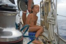 On one of the rare calm days at sea, Kara gets a shower, en route to Australia