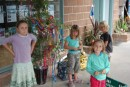 the cruising kids decorate the bamboo christmas tree at the marina