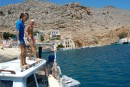 Kara and Lewis from Germany enjoy diving off Magnum to cool off in the high temperatures at Symi Island