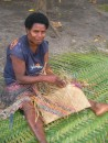 local village woman weaving basket