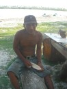 Clemente carving little canoe