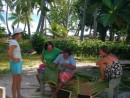 ladies weaving palm fronds