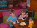 Geordi and Annika getting into chocoalte cake on baord Valiam