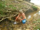 washer woman in creek