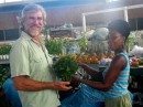 Bill buying home grown spinach Scarborough Tobago
