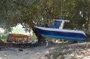 Yikes!  Many boats were thrown up on shore - luckily in Samoa, no cruising boats were damaged.  In American Samoa, however, several were destroyed and all of the 15 in the Pagopago anchorage were damaged.