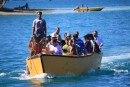 The first boat load of guests being ferried into the lagoon for the 2 week Church of Tuvalu gathering