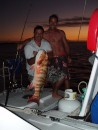 Andrew and Jason with dinner off Howick Island