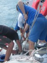 """Brooming the fish"" or the  expert way of holding a mackeral down with the deck broom, whilst others grapple with it!!"