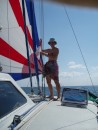 Dianne hoisting the Indonesian Courtesy Flag as we approach Timor.  Quite a bit  of MPS or Spinnaker Sailing in these light breezes of the tropics