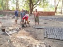 Making mud bricks for housing at Wodong - see story