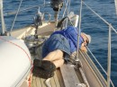 Bill asleep at the rail as we sail along