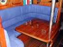 New Saloon Table made from teak that drops down to make a saloon bed and also new settee covers