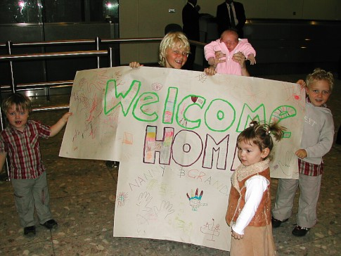 Welcome Home: A great home coming welcome from our grandchildren on our arrival at Heathrow airport UK after our flight from Oz.